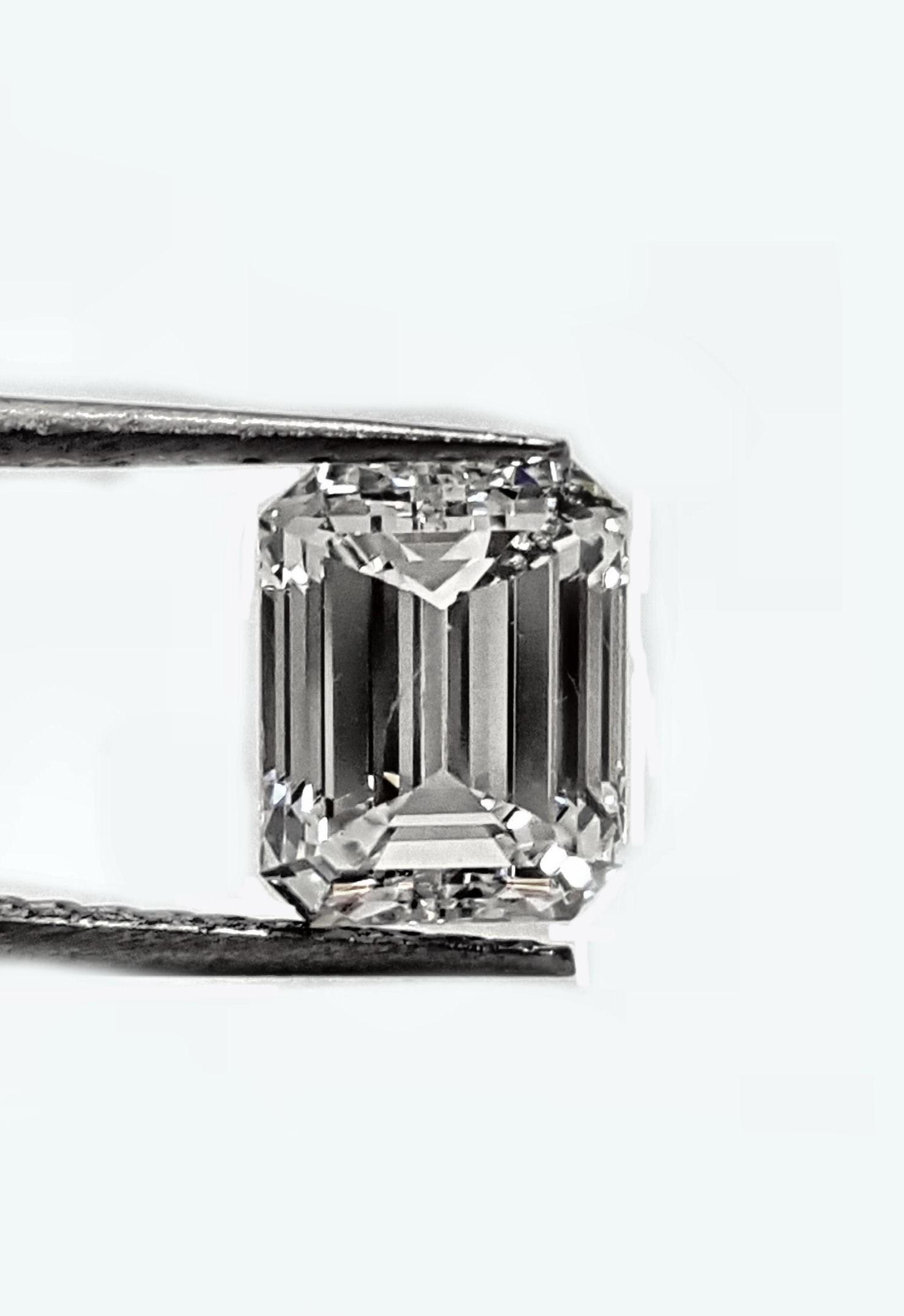 91pt. Emerald cut 91pts. H SI1 GIA certified