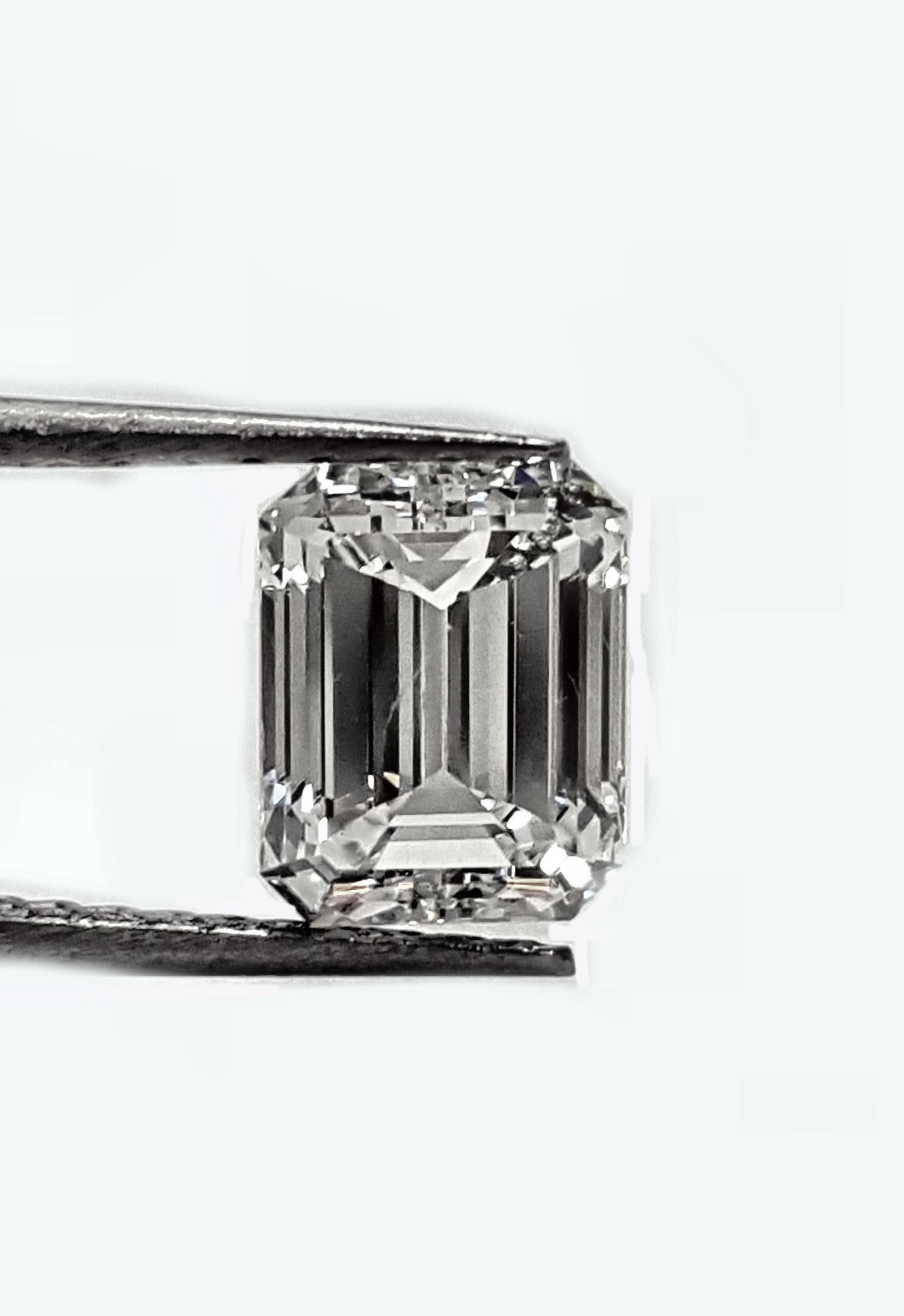 91pt. Emerald cut 91pts. H SI1 GIA certified