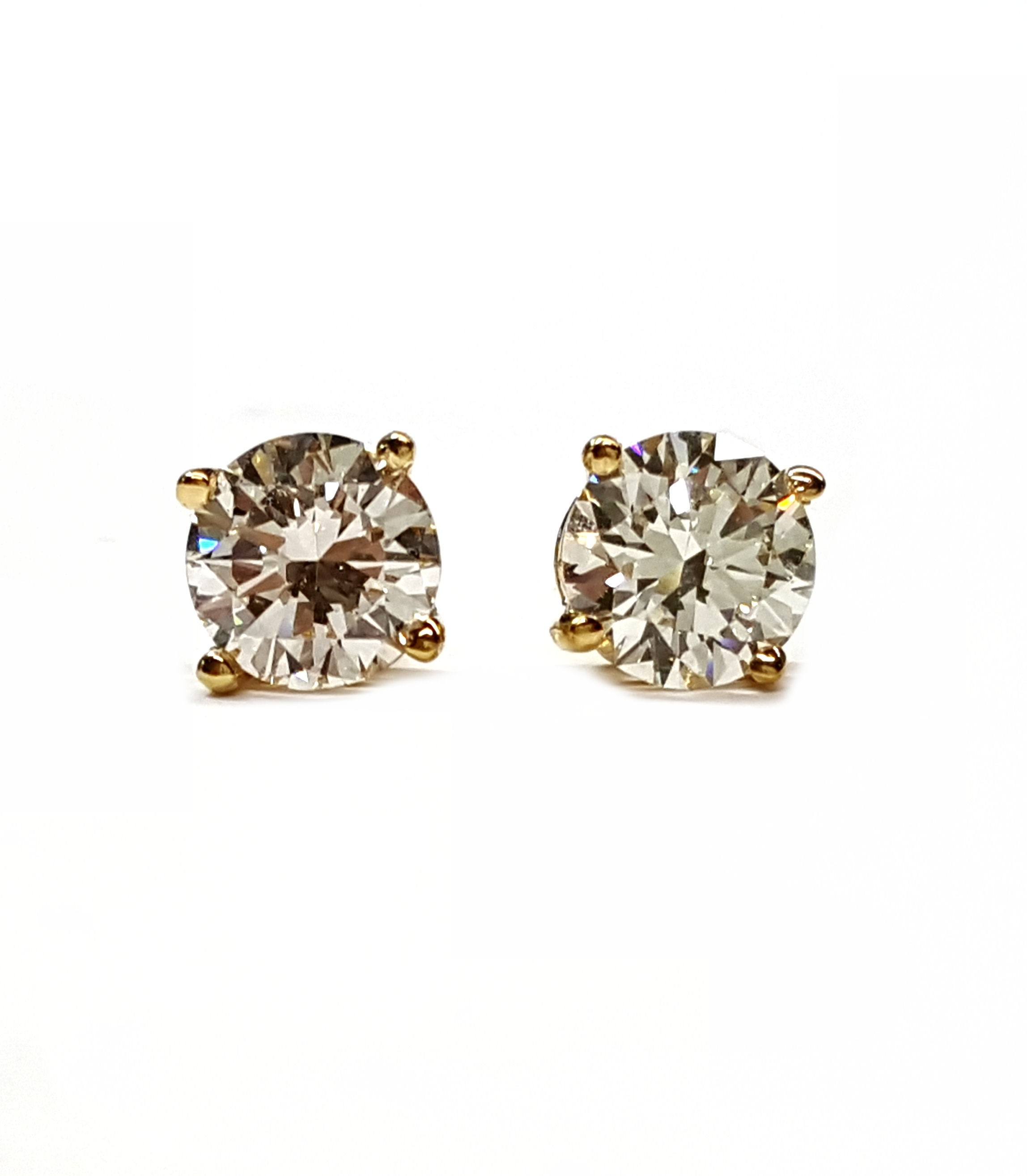 Diamond stud earrings set 4 prong yellow gold 2=35pts. t.w.