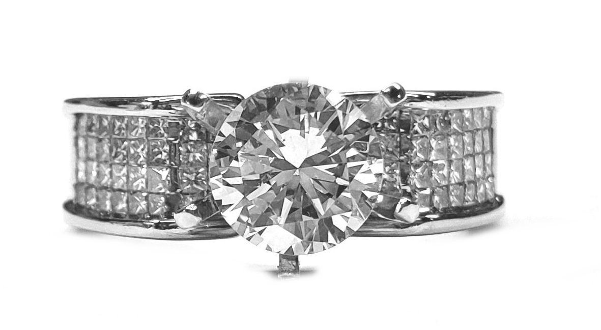 2.64ct. Diamond Engagement Ring, 14kt. Gold, 1.50ct Center
