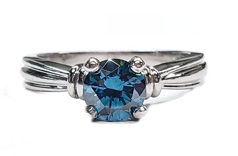 "Platinum Engagement Ring ""SCOTT KAY"",70pt. Blue Diamond"