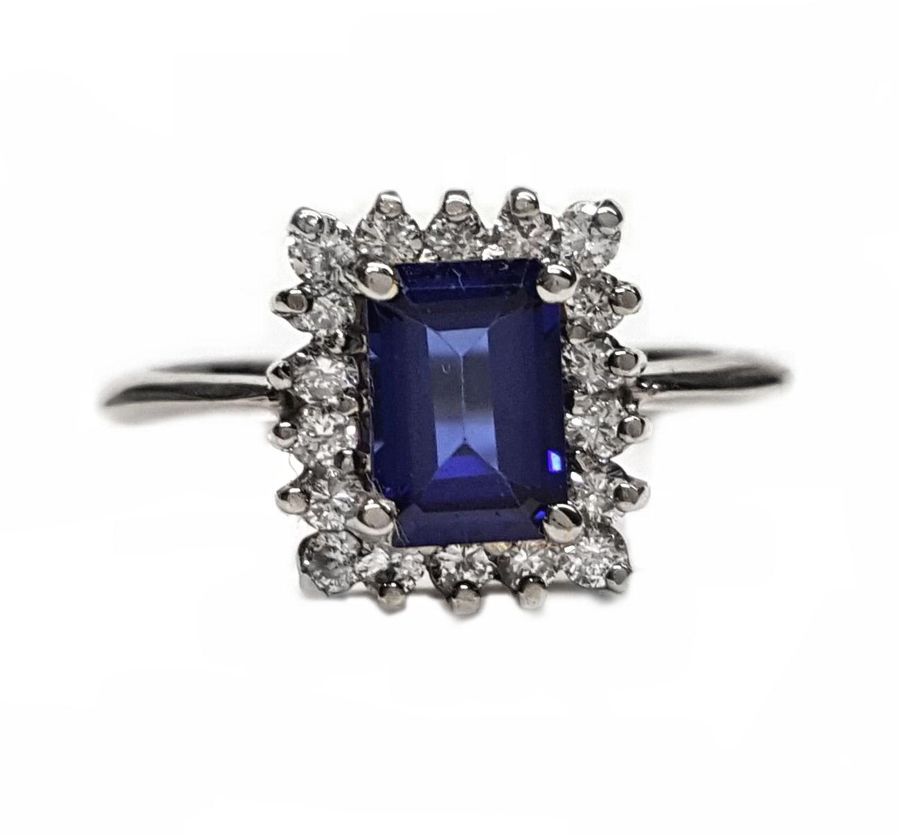 Emerald Cut sapphire & diamond cluster ring, 48pts dia's. t.w.