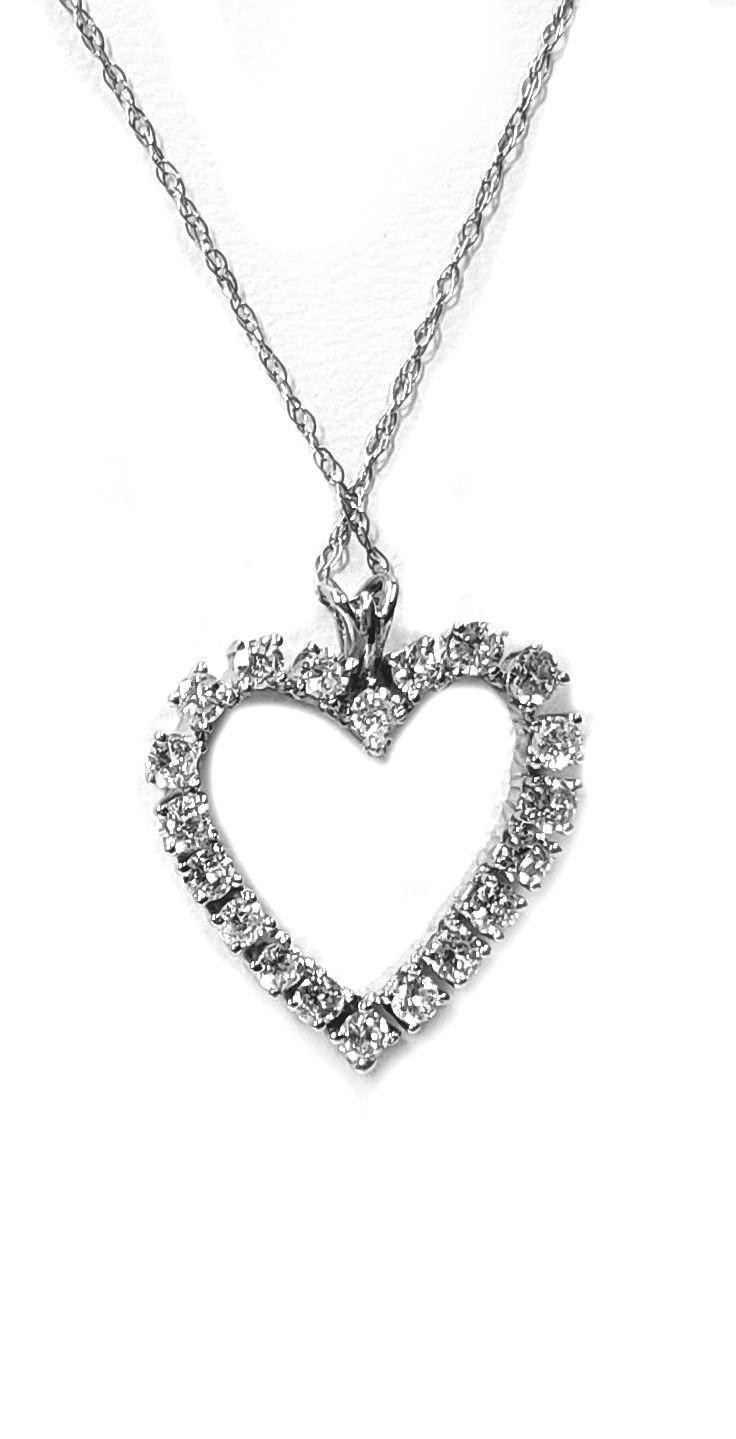 Diamond Heart Pendant Open Center. 95pts. t.w. Set in 14ti Gold